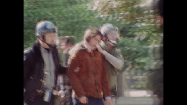 student anti-war demonstrators are led away by police in handcuffs as protest gets out of control at the university of california berkeley in april... - vietnam war stock videos & royalty-free footage