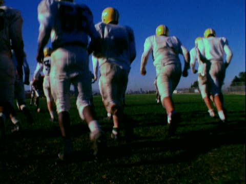 MONTAGE Student athletes practicing high school football / California, United States