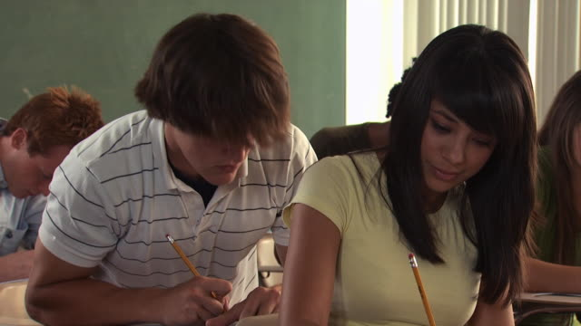 student cheating on a test - see other clips from this shoot 1148 stock videos and b-roll footage