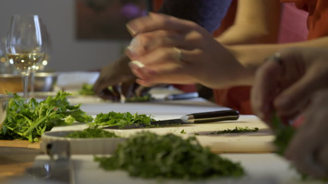 student chefs clearing parsley off cutting boards - parsley stock videos and b-roll footage