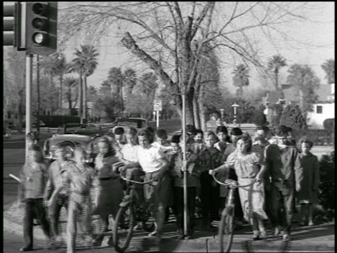 vidéos et rushes de b/w 1954 student crossing guard turning sign + students crossing street / industrial - 1954