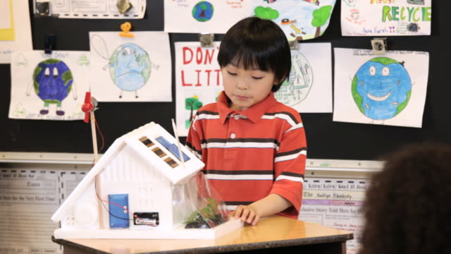 ms tu student demonstrating solar house project to class / richmond, virginia, united states     - school bulletin board stock videos and b-roll footage
