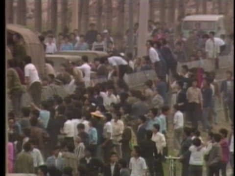 student demonstrators climb over a cement wall in china. - tiananmen square stock videos & royalty-free footage