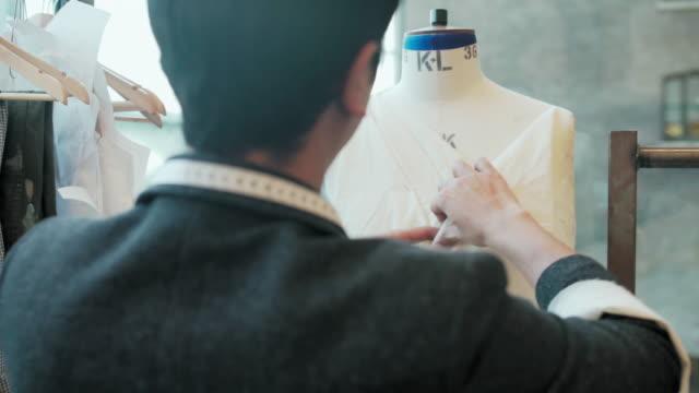student dressing dressmaker's model - tape measure stock videos & royalty-free footage