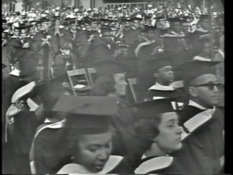 Student enter Dr James M Nabrit president of Howard University introduces President Lyndon Baines Johnson