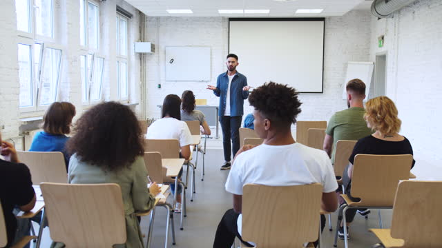 student gesturing while giving speech in classroom - three quarter length stock videos & royalty-free footage
