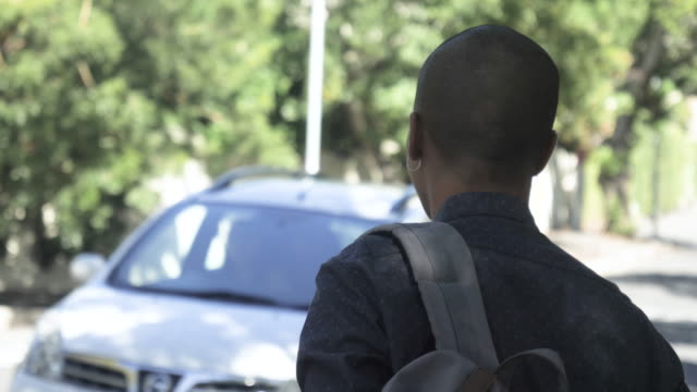 student gets into car, slow motion - windscreen stock videos & royalty-free footage
