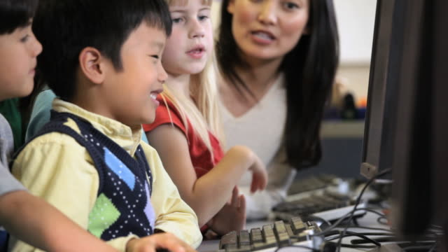 cu tu pan student in computer class with teacher / richmond, virginia, united states     - elementary school stock videos & royalty-free footage