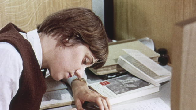 1965 ds student in the library studying and writing / university of sussex, england, united kingdom - sussex stock videos and b-roll footage