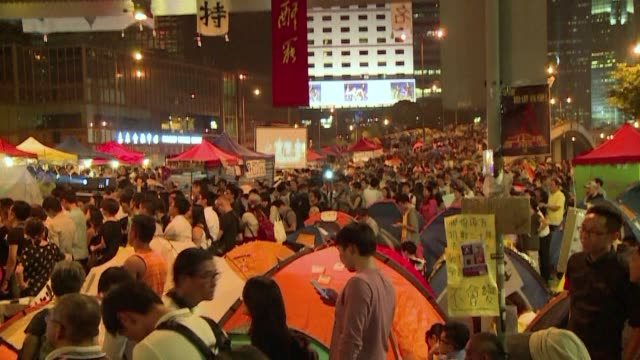 student leaders and occupy central co founder call on crowds to remain on the streets to keep pressure on hong kong's government after the first... - occupy central stock videos & royalty-free footage