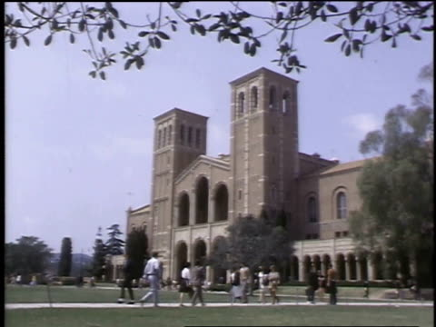 1968 MONTAGE Student life at UCLA quad with students walking and lounging / Los Angeles, California, United States