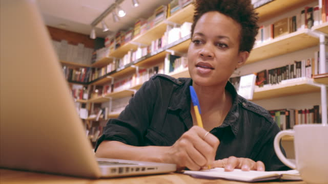 student noting ideas. - library stock videos & royalty-free footage