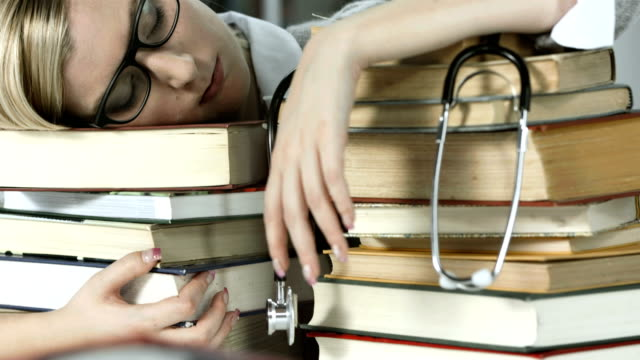 HD DOLLY: Student Of A Medicine Sleeping On Books