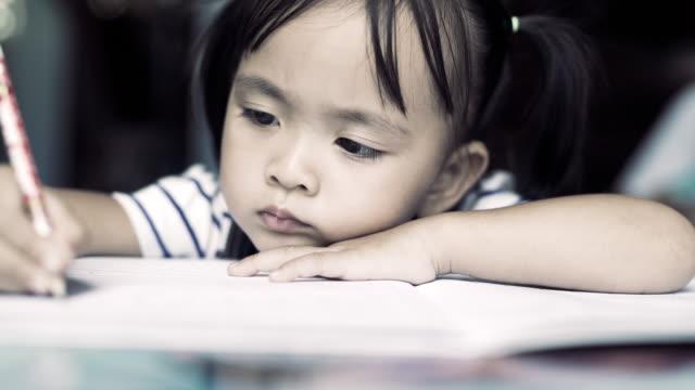 A student of industrious women doing her homework.