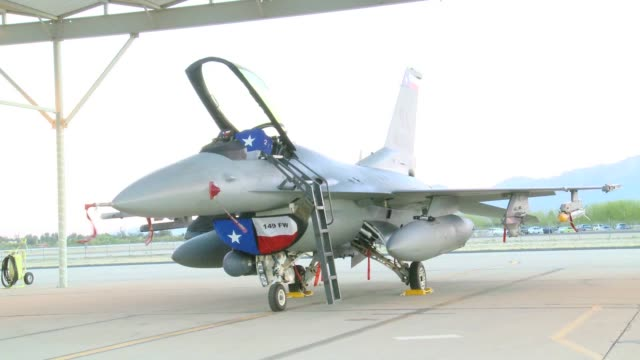 student pilots from the 149th fighter wing from lackland afb, tx, pre-brief and taxi for take-off to fly f-16d fighting falcons for coronet cactus, a... - 2014 stock-videos und b-roll-filmmaterial