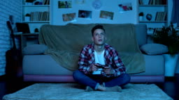 Student playing video games late at night instead studying, game addicted boy