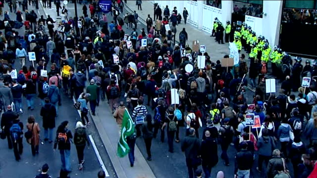 student protest march / marchers at moorgate; ** music heard over following shots sot ** high angle shots police officers in riot gear lining... - pavement点の映像素材/bロール