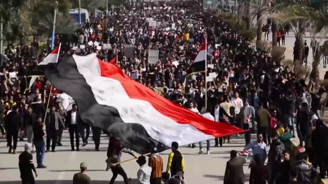student protesters take to the streets in najaf southern iraq to demand snap elections as well as an independent successor to prime minister adel... - nachfolger stock-videos und b-roll-filmmaterial