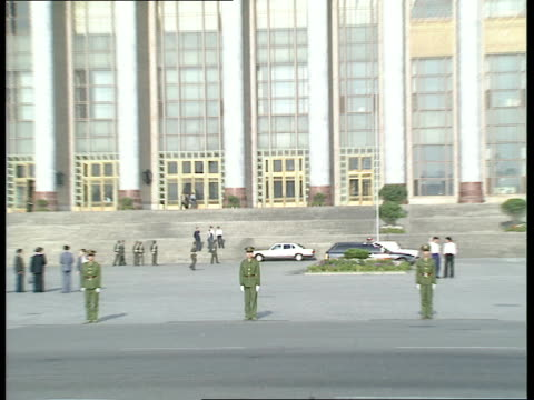 beijing tiananmen square ext liberation army soldiers marching in formation across square / soldiers marching across road / car along as arriving at... - tiananmen square stock videos & royalty-free footage