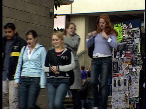 student radicalism; itn england: east anglia: norwich: int male student at stall 'don't attack iraq' persuading another student to sign petition... - east anglia stock videos & royalty-free footage