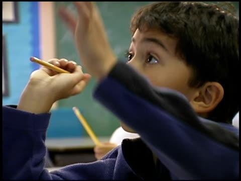 student raising hand in classroom  - human limb stock videos & royalty-free footage