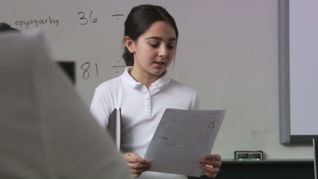 student reading at the head of the class - see other clips from this shoot 1148 stock videos & royalty-free footage