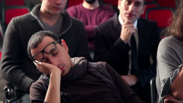 stockvideo's en b-roll-footage met student sleeping during a conference - conferentie