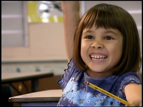student smiling and raising hand in classroom - human limb stock videos & royalty-free footage