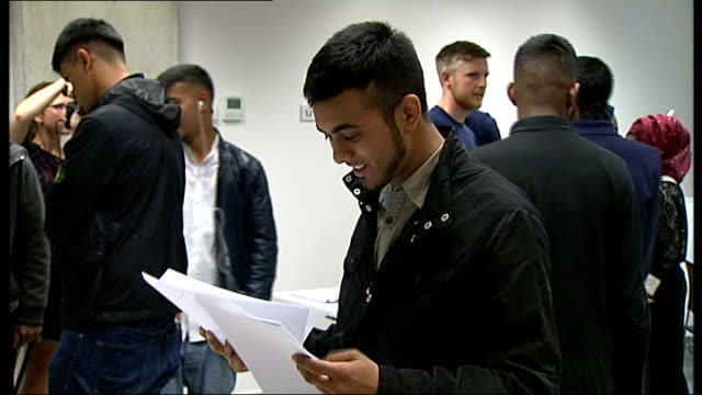student stabbed to death in poplar scored top grade gcse results; england: london: int imran chowdhury looking at gcse result papers nerin khanom... - 一般教育証明試験点の映像素材/bロール