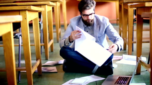 student struggling with papers. - sitting on floor stock videos & royalty-free footage