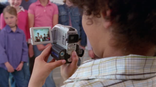 student taking portrait of classmates and teacher with digital camcorder / looking over shoulder and smiling at camera / gorham, maine - digital camcorder stock videos & royalty-free footage