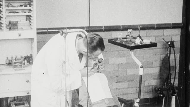1925 montage student undergoing eye exam by optometrist, another receiving a dental exam and nitrous oxide as dentist begins extraction in school infirmary / newcastle upon tyne, england, united kingdom - dental hygiene stock videos & royalty-free footage