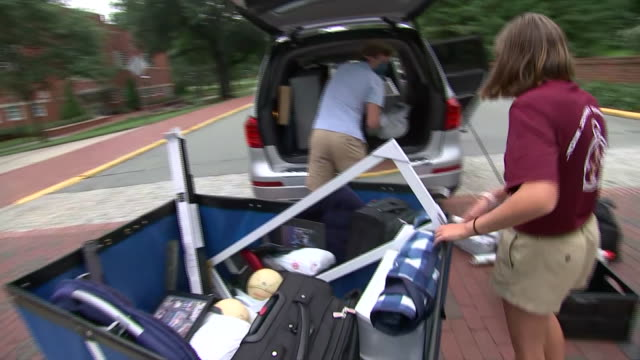 student unloads his belongings from a car during move in day amid the coronavirus pandemic at elon university in elon, north carolina. - healthcare and medicine or illness or food and drink or fitness or exercise or wellbeing stock videos & royalty-free footage