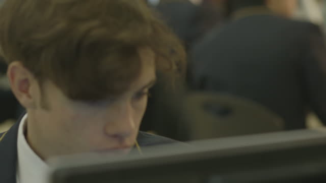 Student using computer in class