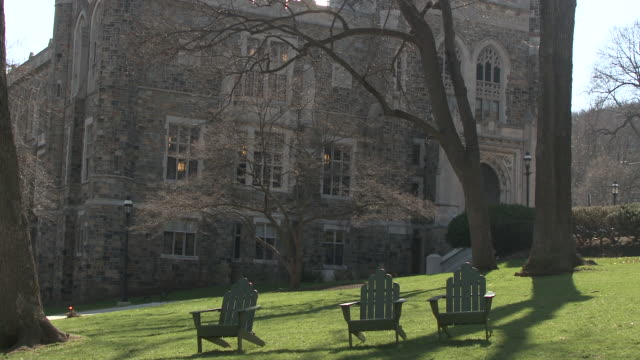 ms student walking past empty deck chairs on lawn on university campus, bethlehem, pennsylvania, usa - see other clips from this shoot 1503 stock videos and b-roll footage