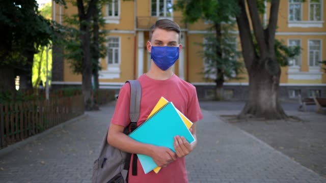 student wearing protective face mask at school - school supplies stock videos & royalty-free footage