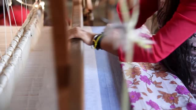 student weaving silk and cotton costumes in a traditional method at a manufacturing unit of parijat academy in gauhati on 25 november 2020. parijat... - girls stock videos & royalty-free footage