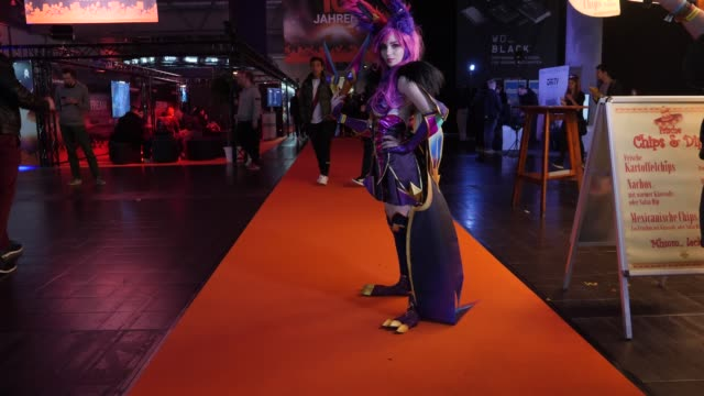 """student who worked for three months on her costume of the cosplay character """"star guardian xayah"""" from """"league of legends"""" poses during a lan party... - cyberspace stock videos & royalty-free footage"""