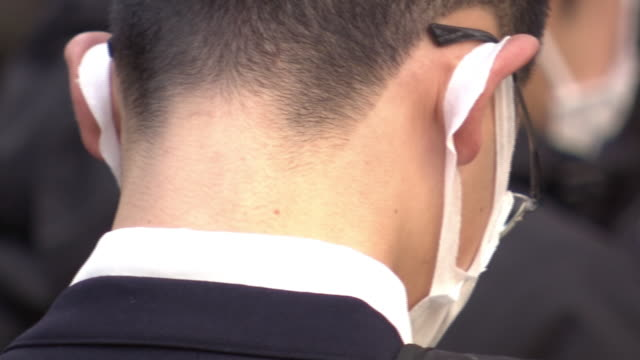 cu, student with surgical mask, tokyo, japan - japan stock videos & royalty-free footage