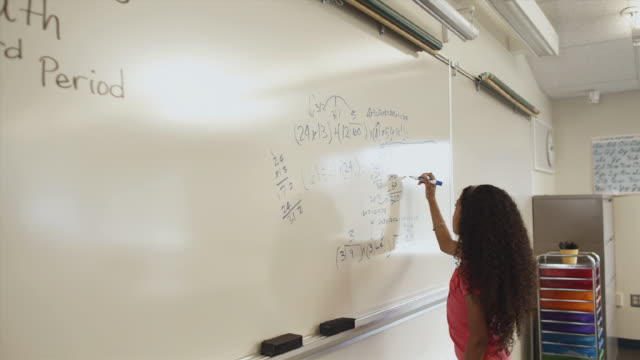 ms pan student working on math problem on whiteboard / edmonds, washington, usa - see other clips from this shoot 1750 stock videos and b-roll footage