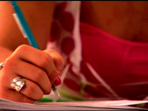 student writing in classroom - one teenage girl only stock videos & royalty-free footage
