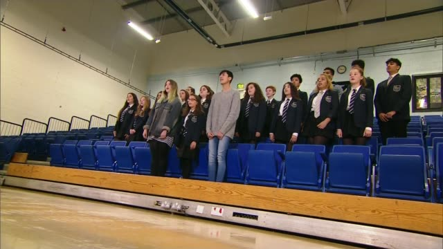 students affected by recent disasters collect a level results t02061708 / 262017 int various of school choir regearsing to take pat in the one love... - choir stock videos & royalty-free footage