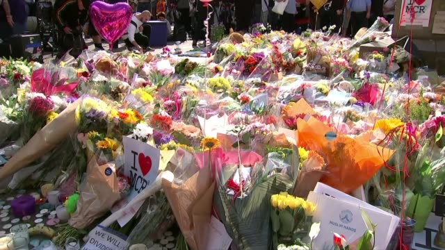 students affected by recent disasters collect a level results may 2017 various of mass of floral tributes messages and candles left for the victims... - manchester arena stock videos & royalty-free footage