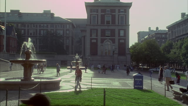 Students and faculty walk across the Columbia University campus.
