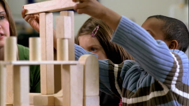 CU Students (5-6) and teacher building tower with blocks, Oshkosh, Wisconsin, USA