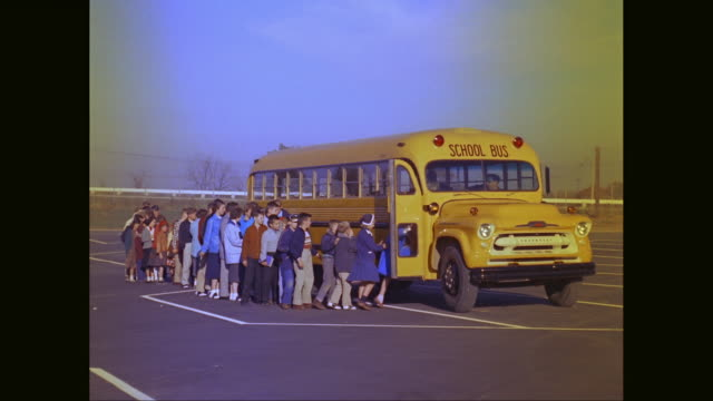 ws students and teachers entering in school bus / united states - 1960 stock-videos und b-roll-filmmaterial