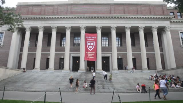 students and visitors pass by the widener library on the harvard university campus in cambridge, ma, on tuesday june 30, 2015. shots: exterior wide... - harvard university stock videos & royalty-free footage