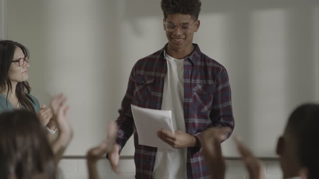 students applauding teenage boy reading essay in classroom / springville, utah, united states - springville utah stock videos & royalty-free footage