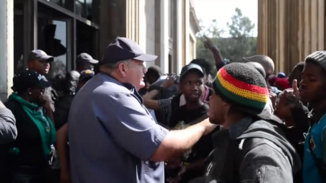 students at the university of the witwatersrand stage a demonstration against the announcement of fee increases on september 20, 2016 in... - confrontation stock videos & royalty-free footage