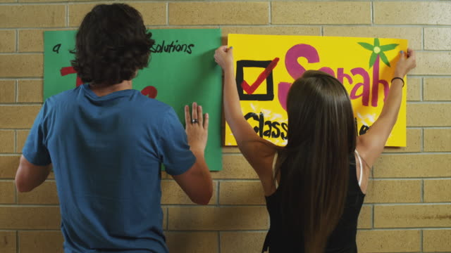 MS ZO Students attaching posters on wall / Spanish Fork City, Utah, USA